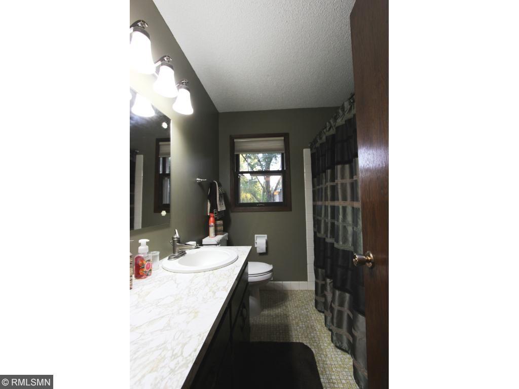 Ceramic Surround and Flooring in Full Bath On Main Level