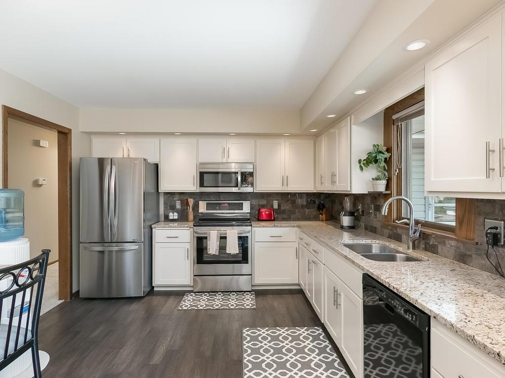 This spacious updated kitchen features brand new granite countertops including the breakfast bar brand new & 7024 Plymouth Avenue N Golden Valley MN 55427 | MLS: 4839387 ...