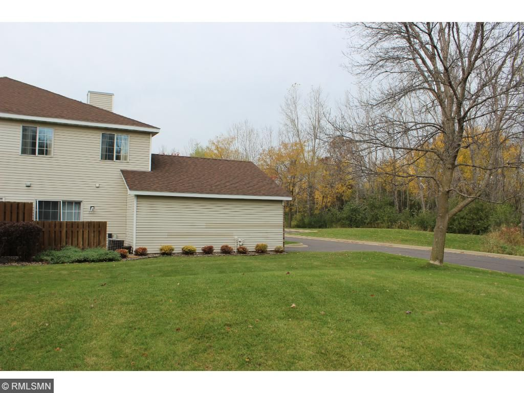 Great end unit with huge yard next to it!