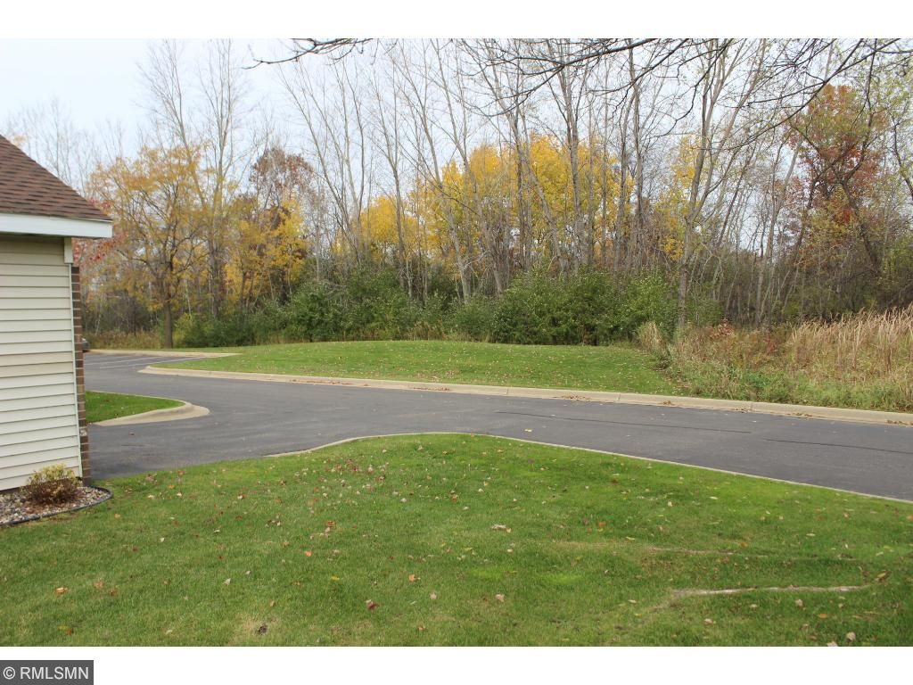 Unit is at back of the unit, on a virtually private street overlooking trees and wooded area!