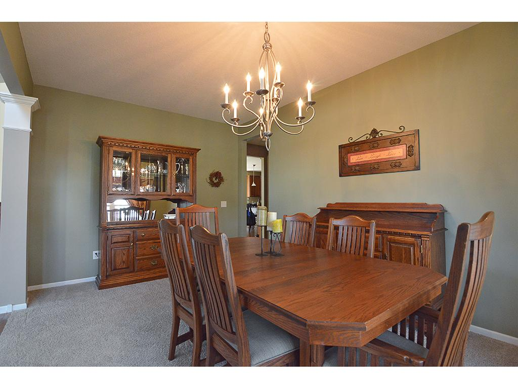 Large formal dining room with lovely lighting fixture.