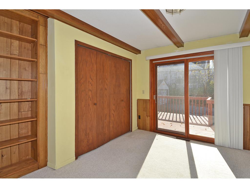 Main floor bedroom with sliding door to south facing deck.