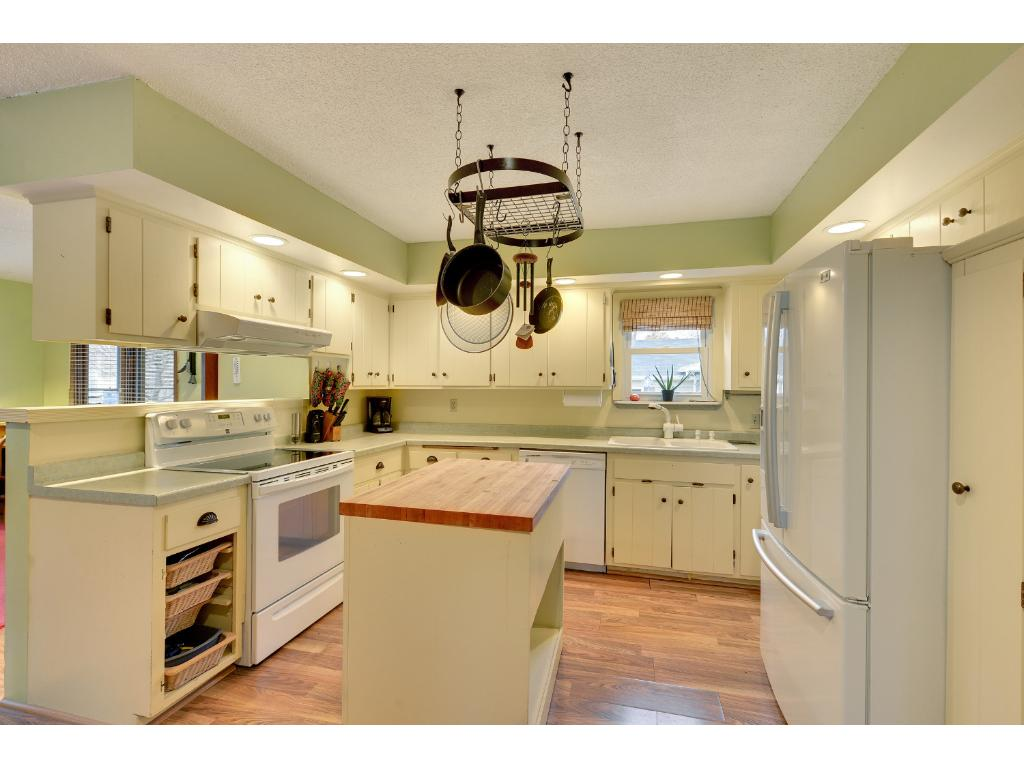 Sunny kitchen is open to family room.