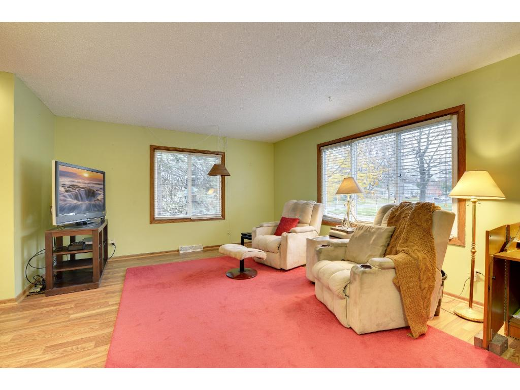 Family room/dining room is perfect for entertaining or as a cozy retreat.