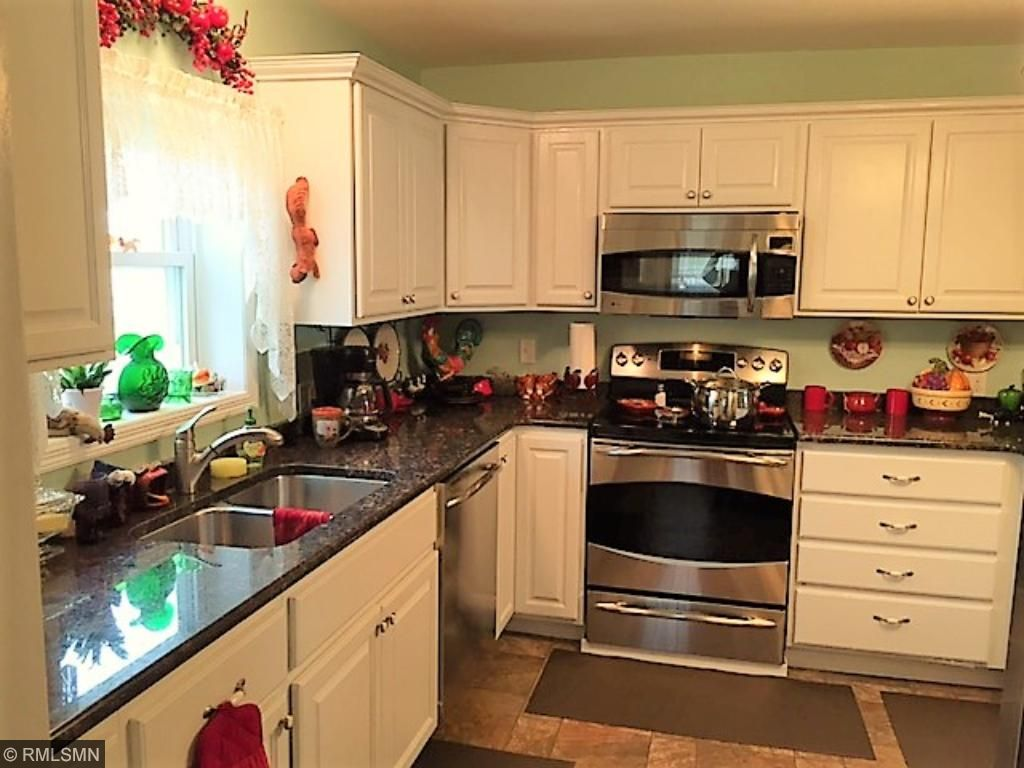 Quality cabinets topped with a rich color granite counter top, just lovely.