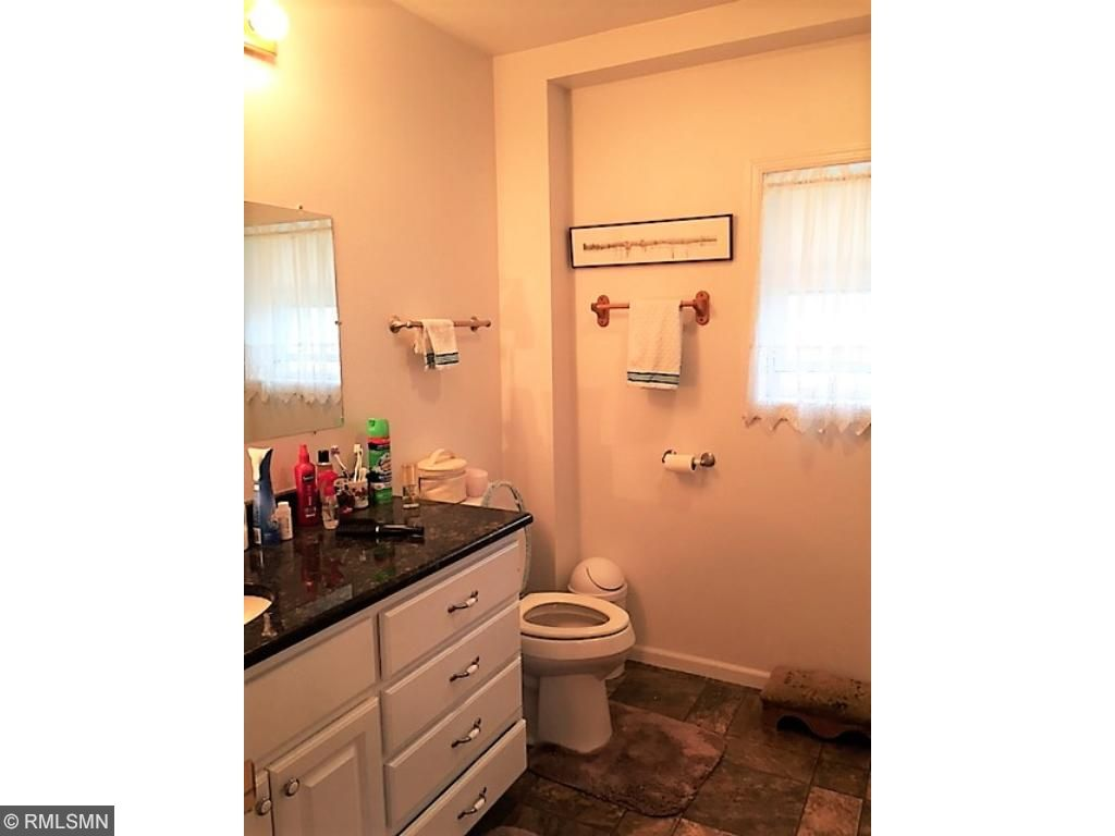 Main floor bath has step in shower and granite vanity top.