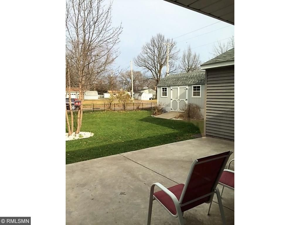 Enjoy the fresh air on the large cement patio just off the sun room.