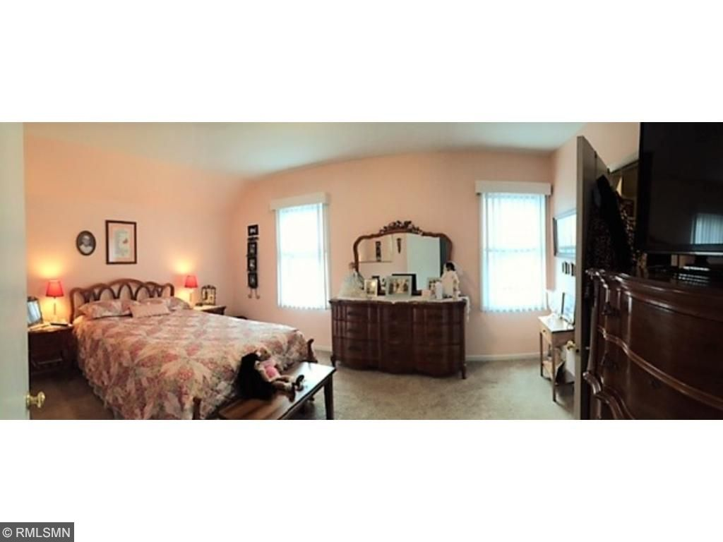A panoramic view of  this bedroom shows the window placement (all new windows) and all the natural light they let in.