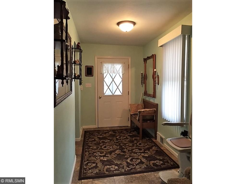 Front entry door leads to the enclosed front porch.
