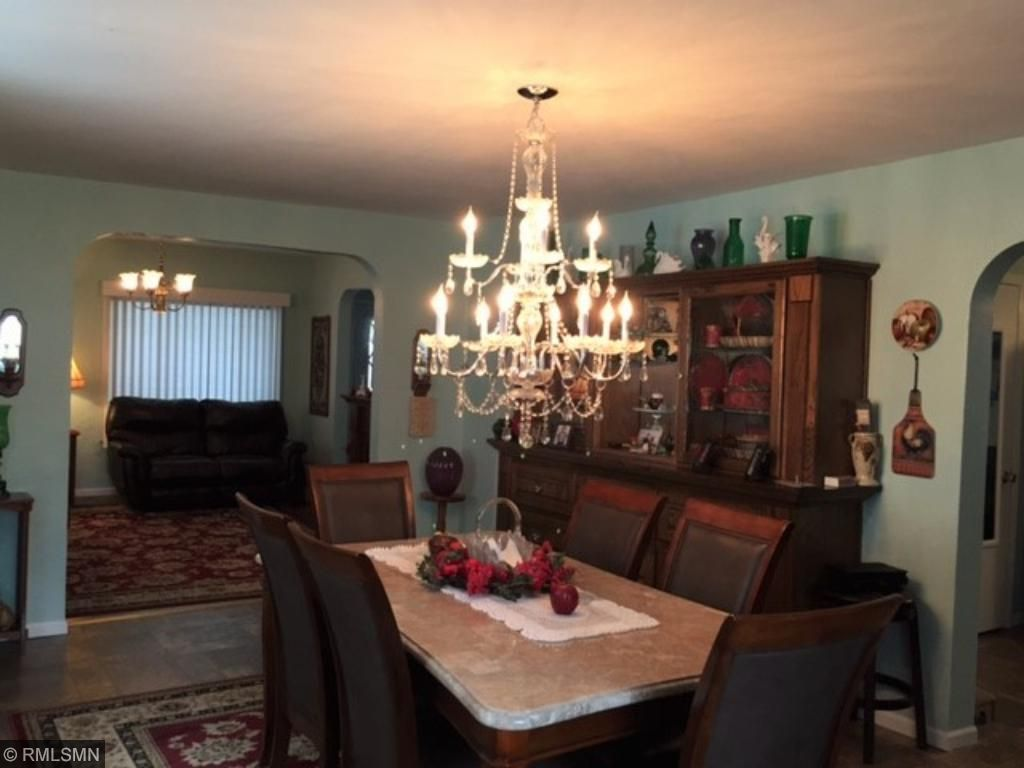 Spacious formal living room with sparkling new chandelier.