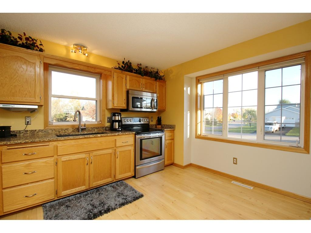 Spacious front-facing kitchen with granite countertops, stainless steel appliances & great natural light!