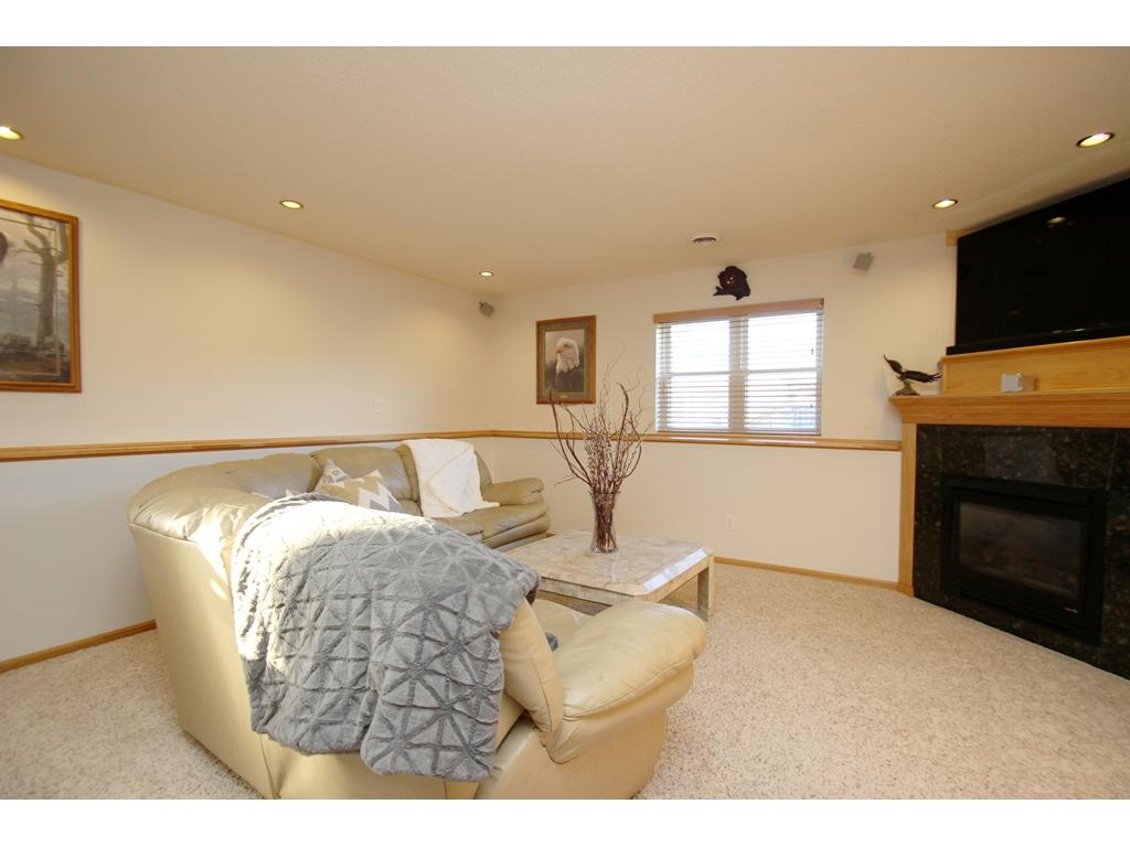 Great family room with recessed lighting, surround sound system, lookout windows, and a beautiful gas fireplace!