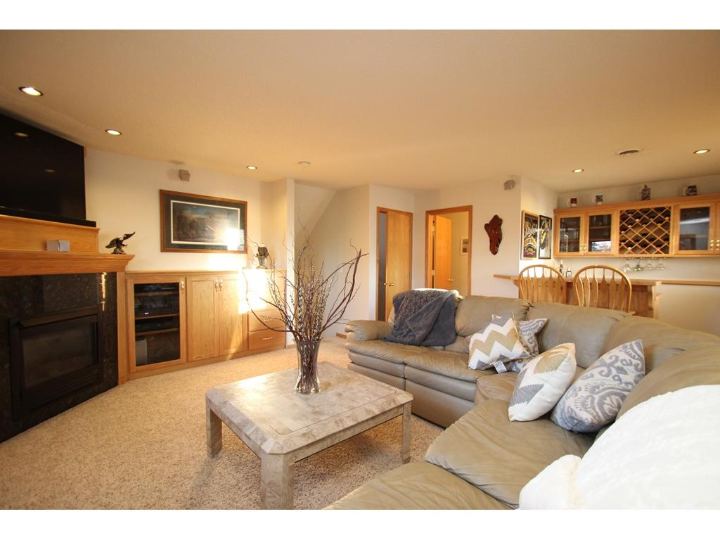 Finished lower level featuring a family room, recessed lighting, a bar for entertaining, bedroom & bathroom!