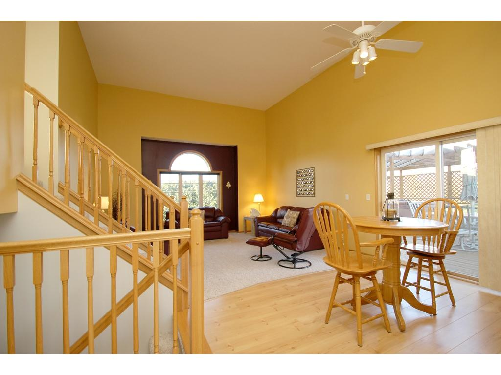 Main floor open floor plan! Beautiful two-story vaulted ceilings! Light & airy feel. Walk-out access to the deck!