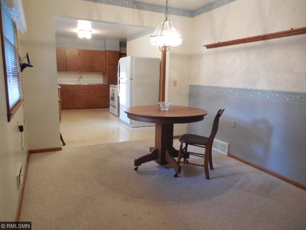 Looking towards kitchen from dining room.