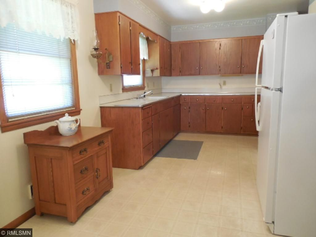 Kitchen features lots of nice cabinetry and space for your desk.