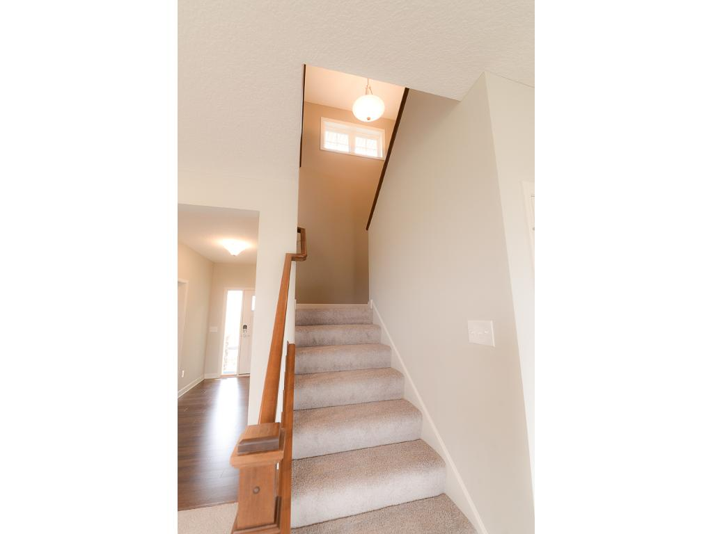 Check out the light filled stairway and lovely wood balusters~