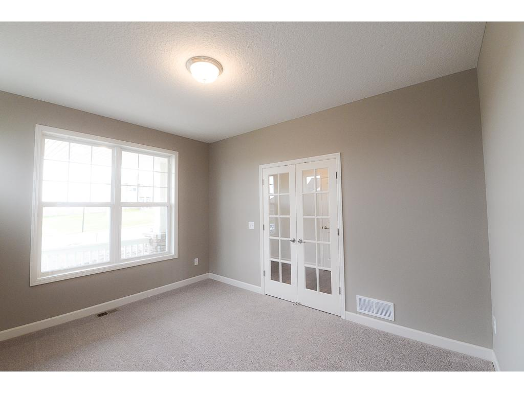 The flex room in conveniently located off the foyer making is perfect for a home office or get away for the kids~