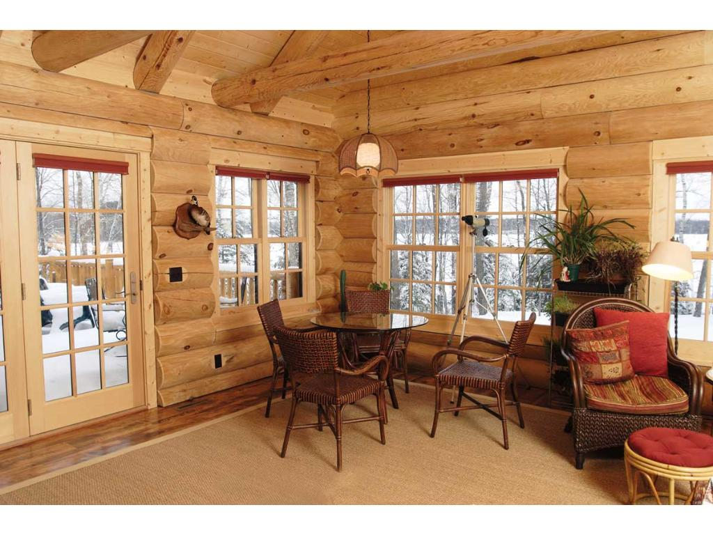 Sunroom! Walk out to the deck, enjoy views of the lake and woods around you! Great space to enjoy that morning coffee, and read a book!