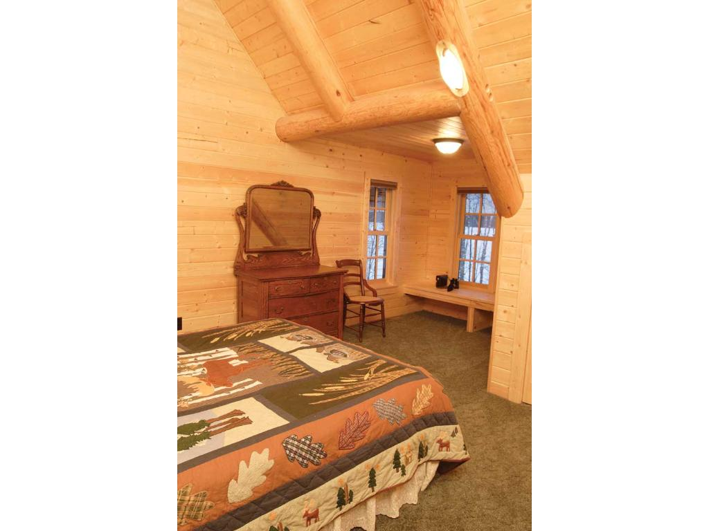 Upstairs bedroom with perch perfect for looking out into the woods or at the lake!