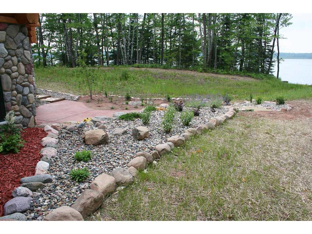 Landscaping around house.  This area leads down to the lake!