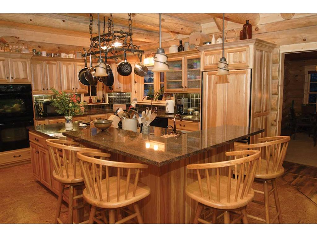 Open concept kitchen looking into main living area and kitchen/dining area.  Great space for entertaining and making memories!