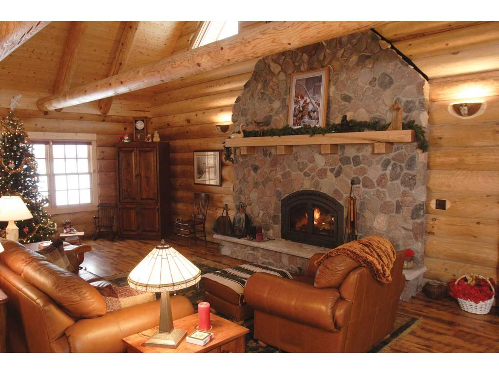 Stone fireplace, stone architecture leads up to the ceiling!