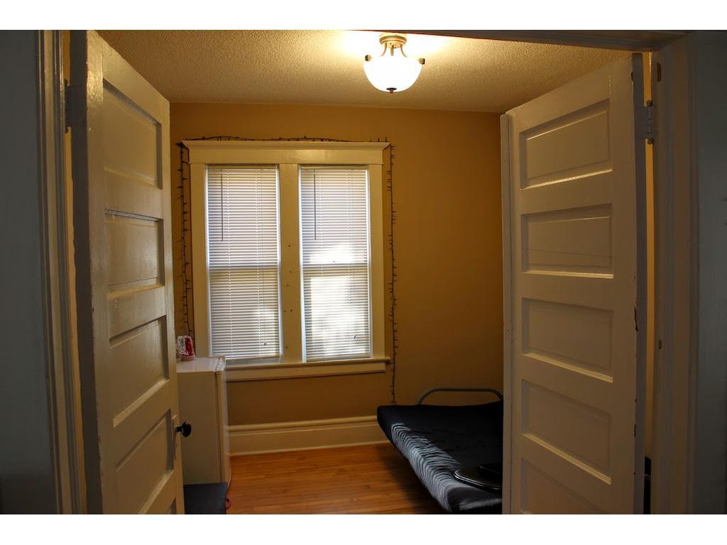 Main level bedroom w/ french doors.
