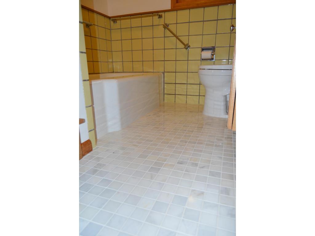 Beautiful marble tile on bathroom floor. European tub/shower. New toilet, vanity & faucets!