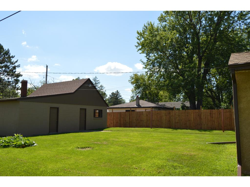 Large yard & 2 1/2 car garage with space for a workshop and much needed storage area above garage for all your extra items.