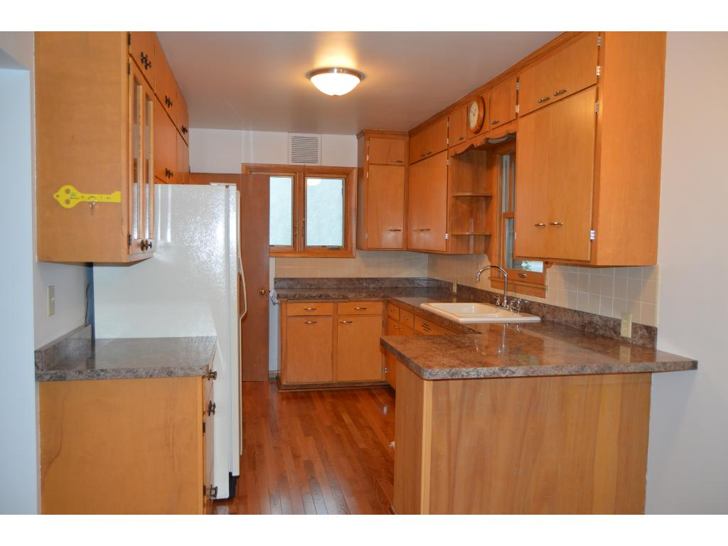 You will love your new kitchen with refurbished cabinets & new counter top!