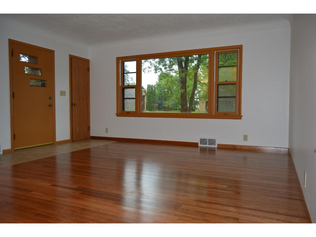 Large living room area with large windows and coved ceiling.