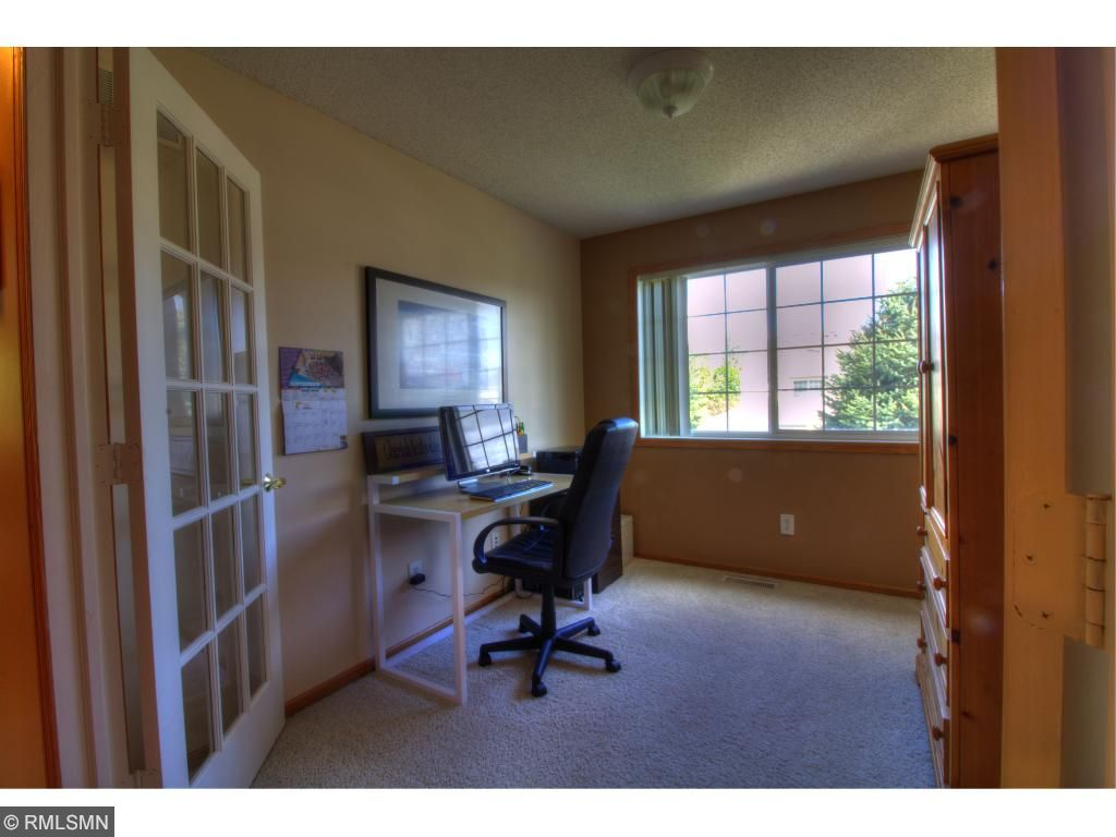 French doors lead to the 3rd bedroom, currently used as an office.