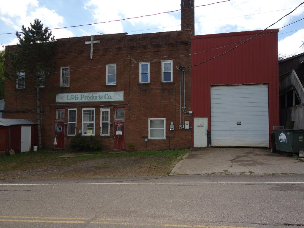 Plenty of opportunity here!  Brick 2-story with Metal attached garage & shops in visible location convenient to freeway access.  3-phase electric in shop.  100 amp elect. in apartment.