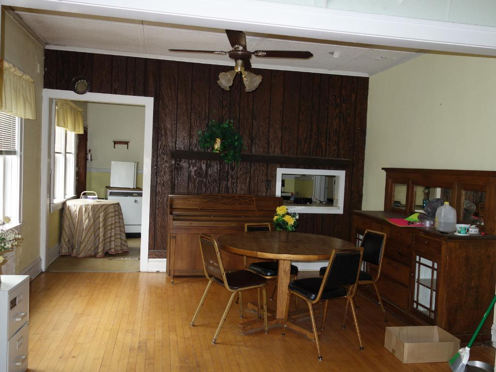 Spacious formal dining room with attached buffet, hwd floors & tall ceilings.  Pass thru area to kitchen.