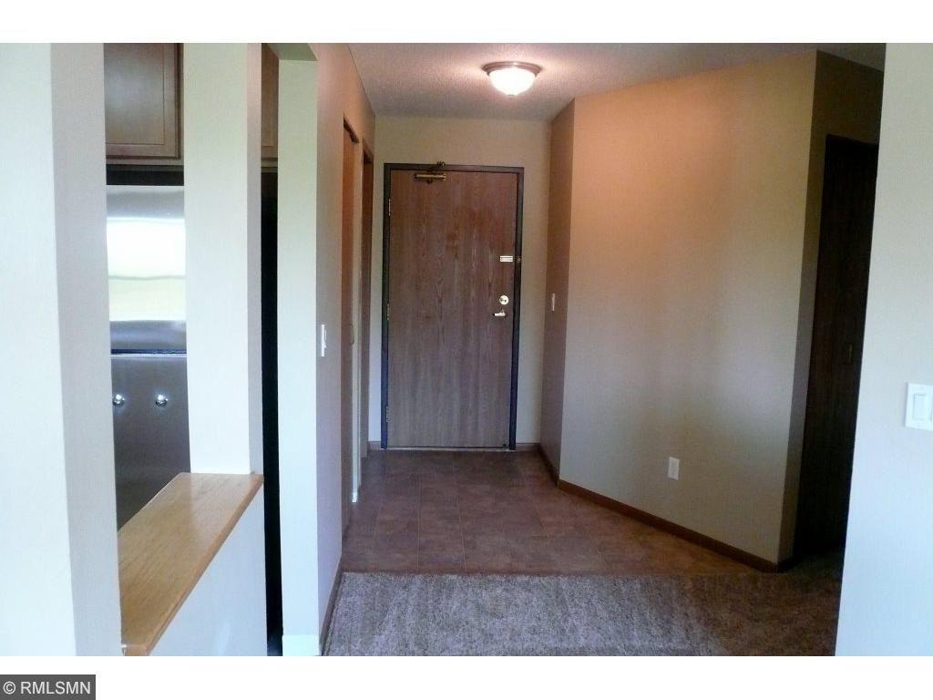 Entryway has closet and large laundry/storage room.