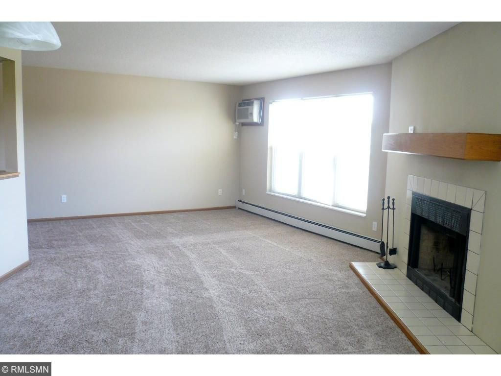 Living room/dining room is one large open space.Windows are all new and tilt out for easy cleaning.Hotwater baseboard  heat is included in the association dues. Window view from living room is the downtown skyline