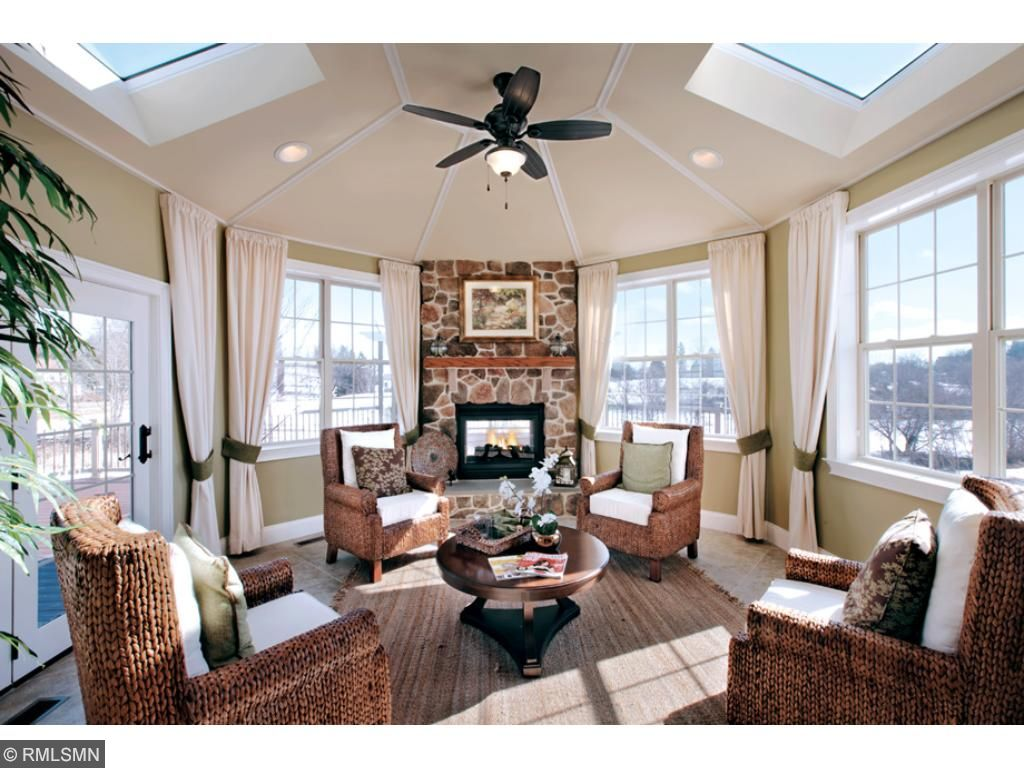 Naples Sunroom option for Stansbury floor plan. Optional skylight windows and fireplace. Design selections available.