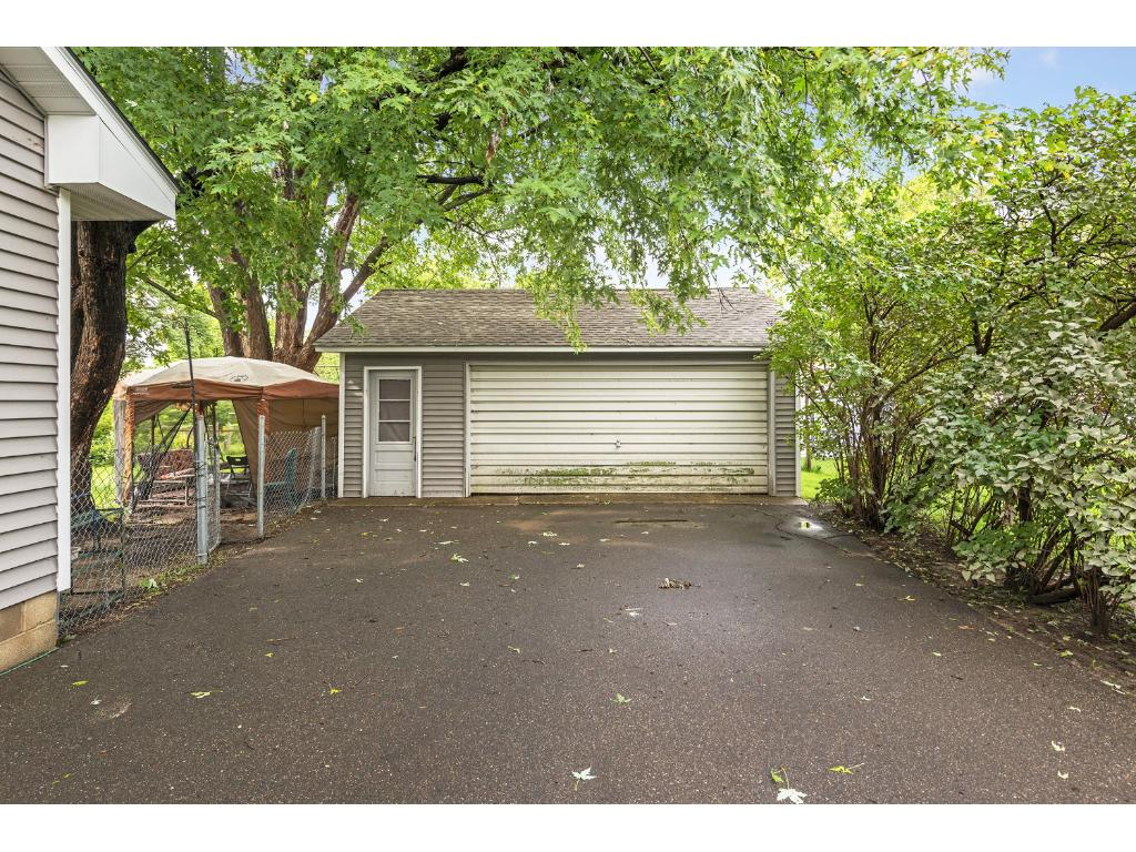 Spacious driveway featuring a two car garage!