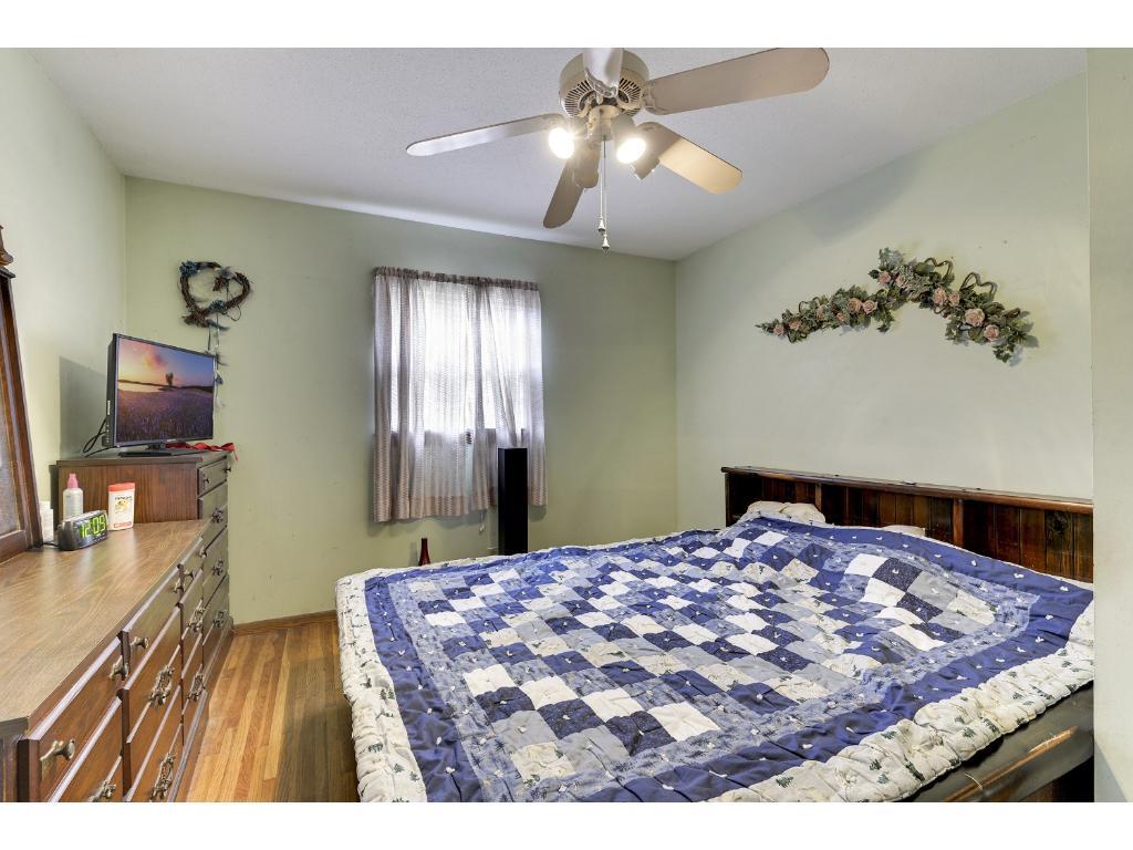Spacious bedroom featuring hardwood flooring!