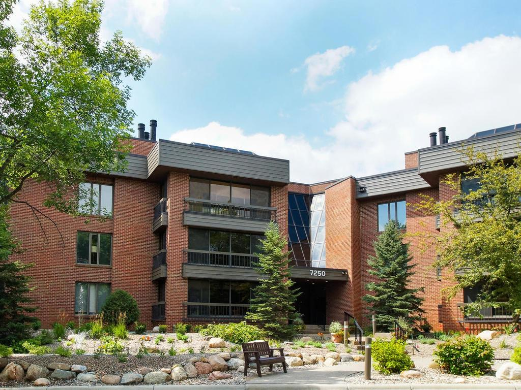 Lewis Ridge! A boutique brick condo building with just 47 units, lovely grounds, and just a few steps to the walking paths of Lewis Ridge Park.