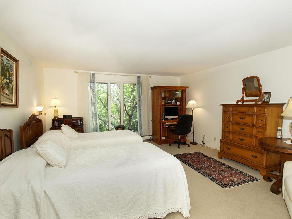 The master suite has plenty of closet space, and adjoins the master bath.