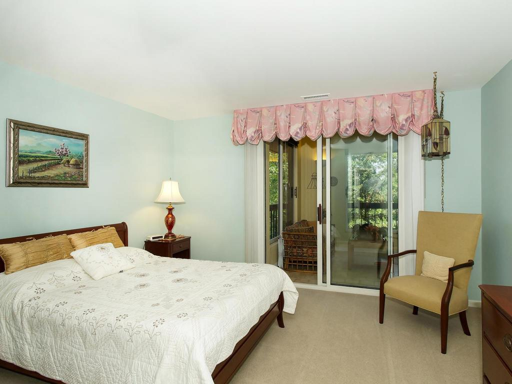 The guest suite has an adjoining bath, and has access to the 3 season porch.