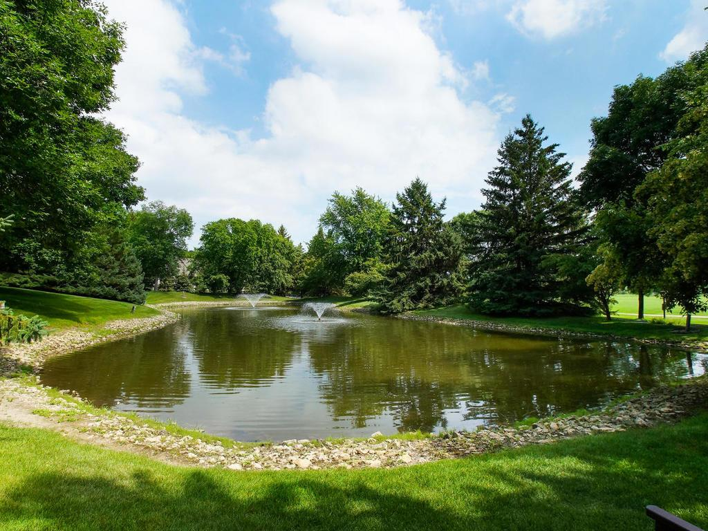 The lush grounds are complimented by a pond with a fountain.