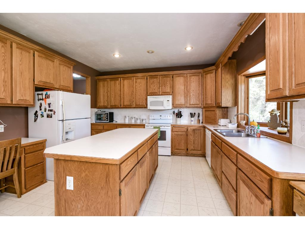 Large Country Kitchen overlooks the beautiful lot!