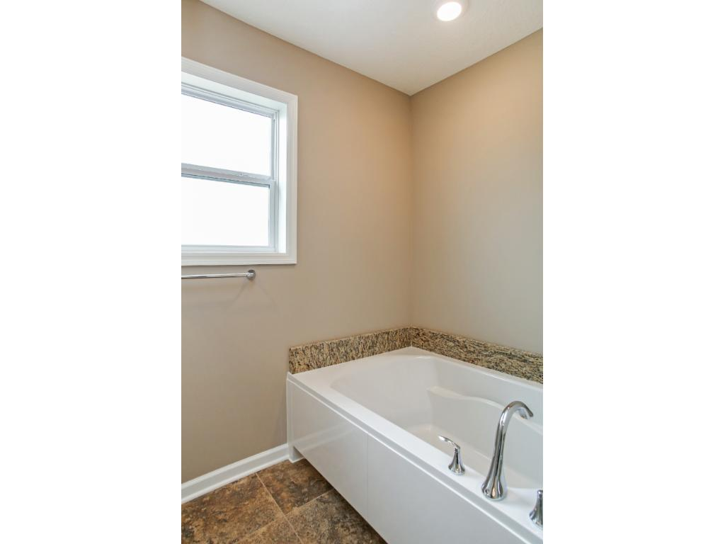 Owners bathroom with separate tub and shower
