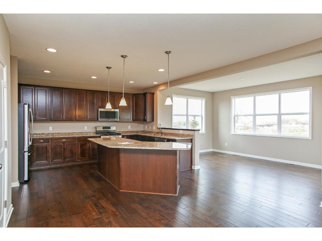 Upgraded kitchen selections with granite countertops and stainless steel appliances