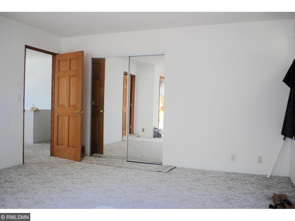 large master bedroom, door to deck.