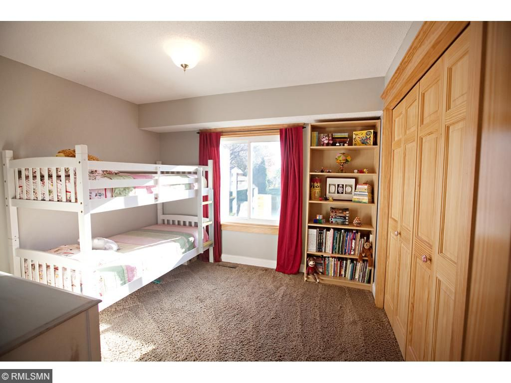The first of 3 bedrooms.  Great space and closets.