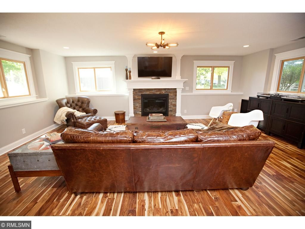 The basement is unbelievable, with a beautifully finished hardwood floors, great natural light and the newly redone fireplace and surround.